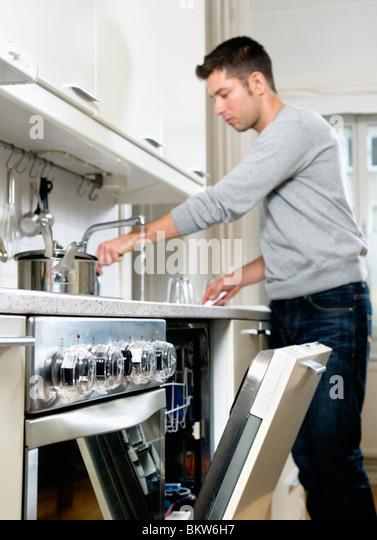 Man in kitchen - Stock-Bilder