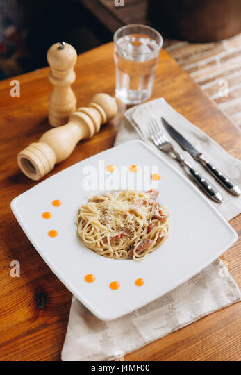 Plate of pasta on table - Stock-Bilder