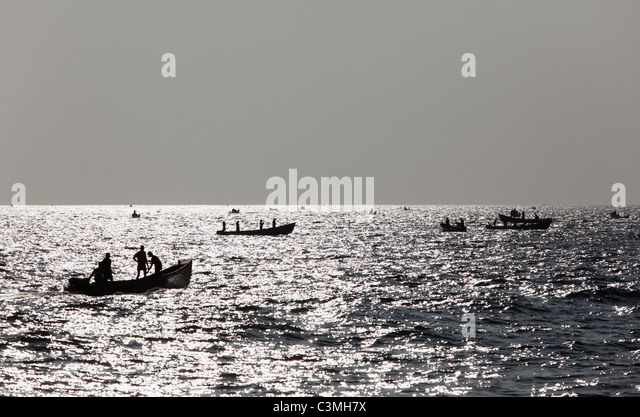 India, South India, Kerala, Malabar Coast, Fishermen on sea at somatheeram beach - Stock Image