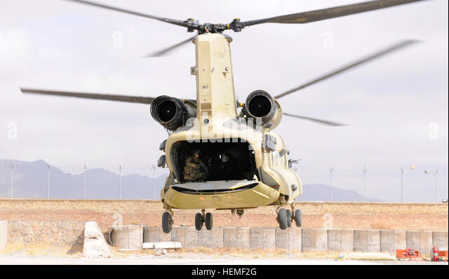 A U.S. Army CH-47 Chinook helicopter transporting wounded veterans participating in Operation Proper Exit arrives - Stock Image