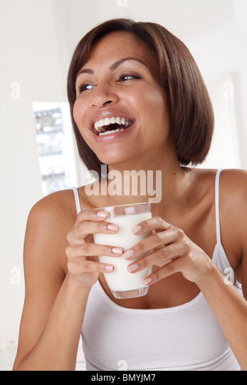 WOMAN WITH GLASS OF MILK - Stock Image