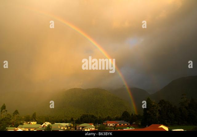 Rainbow at Franz Josef, Fjordland, South Island, New Zealand - Stock Image