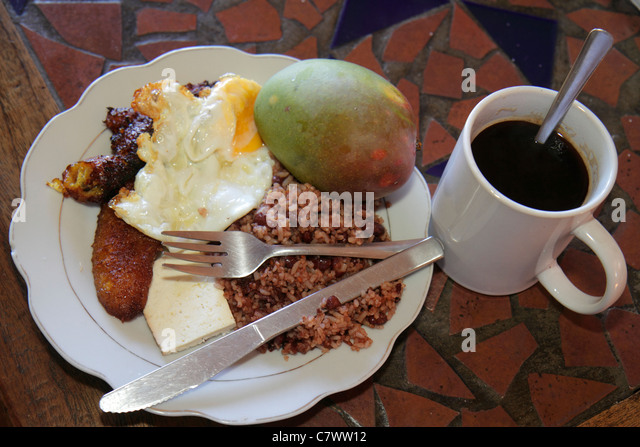 Nicaragua Managua Bolonia Hotel Villa Angelo typical breakfast food plate egg gallo pinto rice beans coffee fried - Stock Image