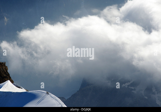 tiny-figures-of-two-mountaineers-dwarfed