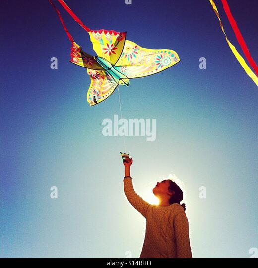 The girl plays with the kite in a bright day - Stock-Bilder