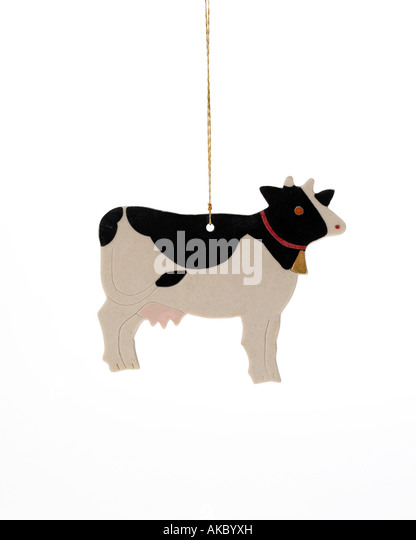 Christmas ornament cow hanging on hook - Stock Image