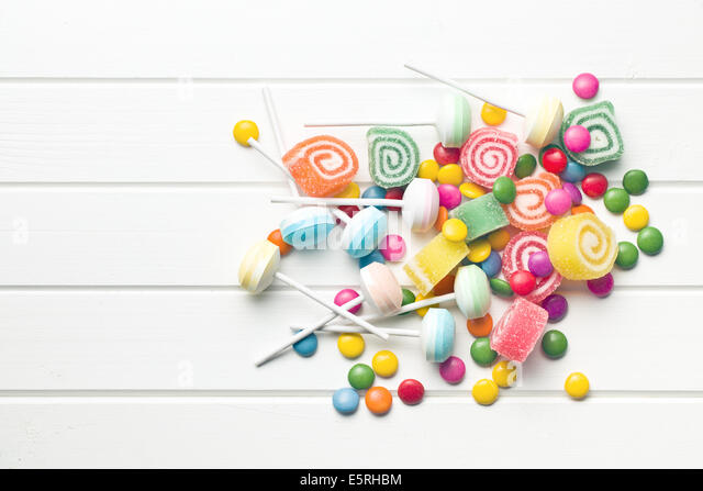 top view of colorful candy on white table - Stock Image