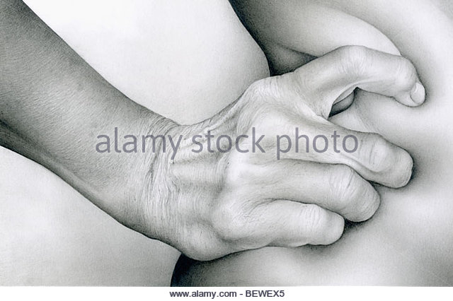 Close up of hand squeezing skin - Stock-Bilder
