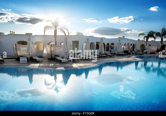 Swimming pool in hotel at the sunrise - Stock Image