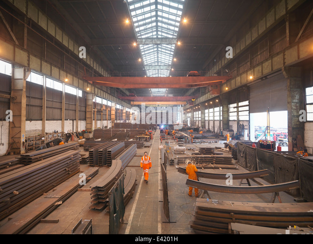 Overview of workers in marine fabrication factory - Stock Image