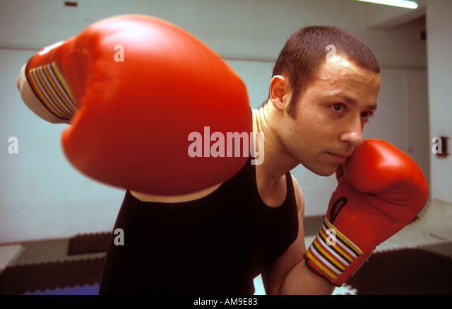 Young man training for boxing. - Stock Image