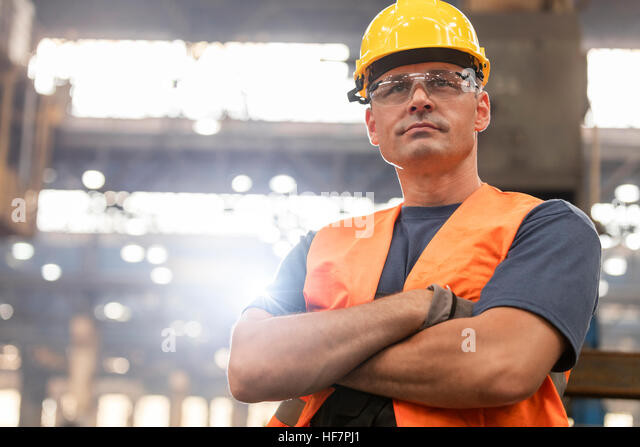 Portrait serious confident steel worker in factory - Stock Image