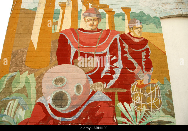 Tarpon Springs Florida Painting of traditional Greek sponge hard hat divers on building wall Sponge Docks - Stock Image