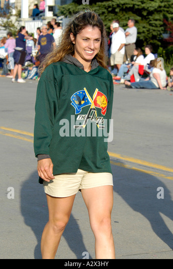 Young Canadian female Ice Hockey Cheerleader on her way to a game in Sarnia - Stock Image
