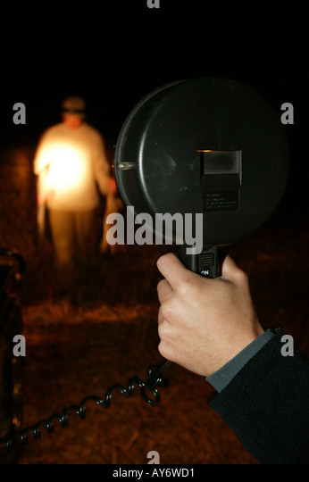 Lamping. Using A High Powered Torch To Hunt And Shoot Rabbit At Night    Stock