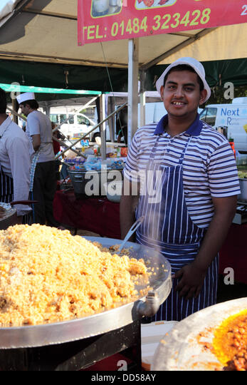 Newcastle-upon-Tyne, UK. 26th Aug, 2013. Food is served at Newcastle Mela in Newcastle-upon-Tyne, England. The annual - Stock Image