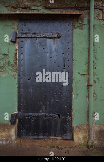 A rusty, corroded metal door at Battery Mendell, an abandoned military battery in the Marin Headlands near San Francisco, - Stock Image