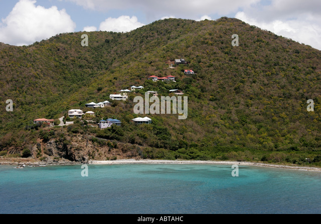 BVI Tortola Caribbean Sea beach hillside houses mountain - Stock Image
