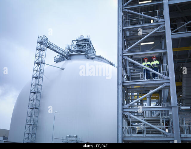 Workers at biomass facility, low angle view - Stock Image