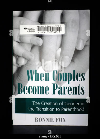A Parenting book photographed against a black background. - Stock Image