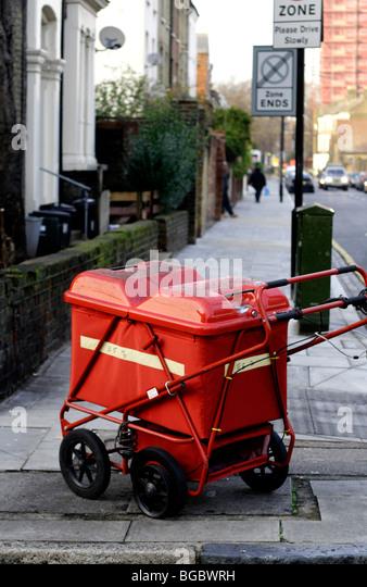 postmen's trolley left on street - Stock Image