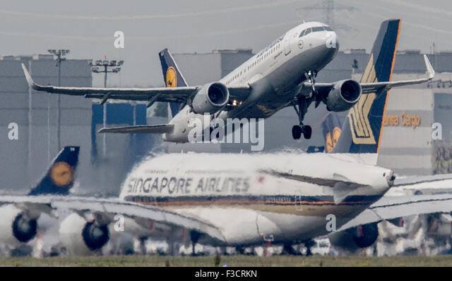A Lufthansa passenger jet takes off in front of a taxiing Singapore Airlines Airbus A 380, in Frankfurt am Main, - Stock Image