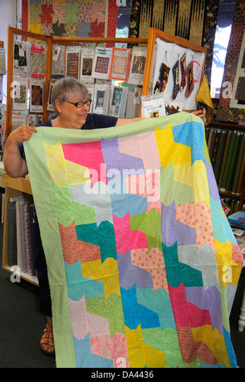 Brooksville Florida quilting supplies sale store shop senior woman quilt - Stock Image