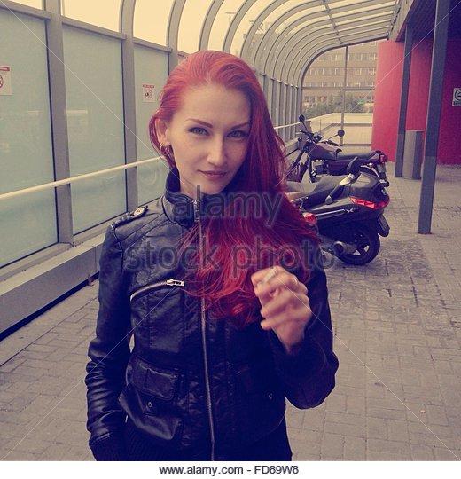 Young Woman Smoking Cigarette - Stock-Bilder