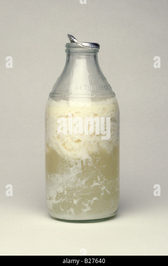 glass bottle of sour milk - Stock Image