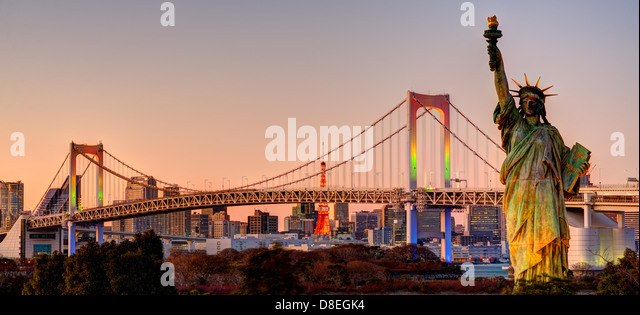 Statue of Liberty, Rainbow Bridge, and Tokyo Tower as seen from Odaiba in Tokyo, Japan. - Stock Image