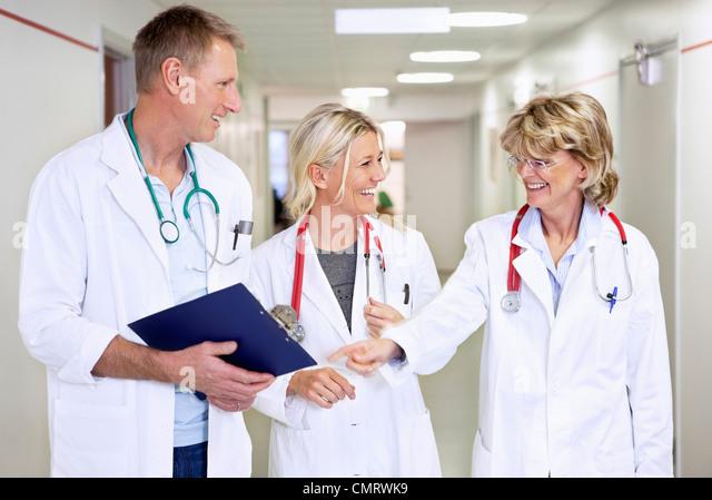 Three smiling doctors - Stock Image