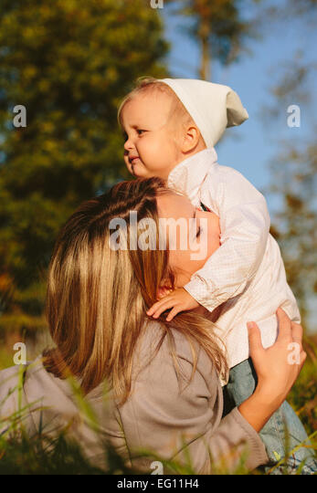 Mum hugging daughter - Stock Image