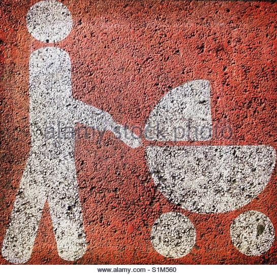 painted sign (marking) on the road of a pedestrian pushing a pram' - Stock Image