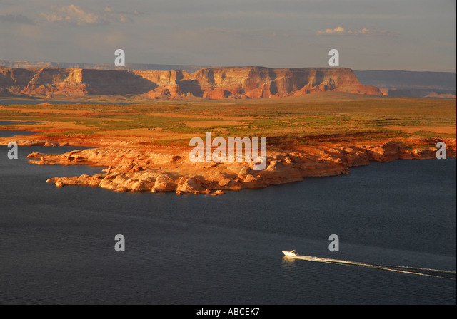 Arizona Lake Powell boating outdoor recreation red mesa background twilight - Stock Image