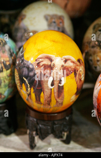 south africa cape town handicraft from township people airport shop ostrich egg painted  - Stock Image