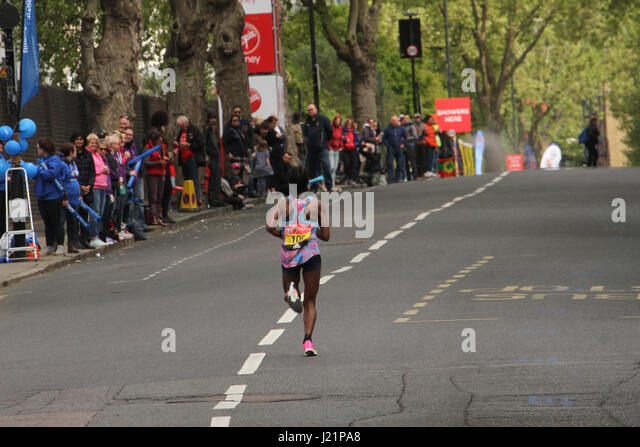 London, UK. 23rd Apr, 2017.   Tigist TUFA (ETH) races towards the 17 mile mark at Madchutte during the 37th London - Stock Image