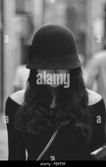 Front View Of Woman With Obscured Face In City - Stock Image