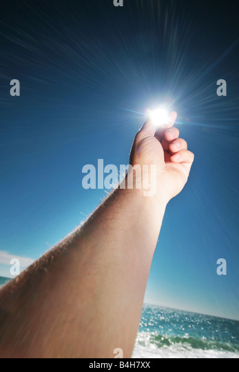 hand holding the sun - Stock Image