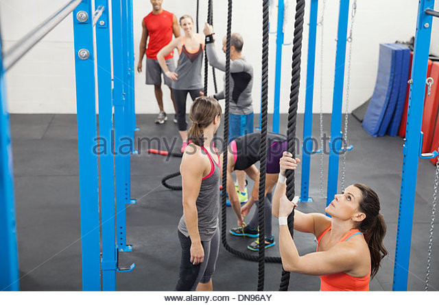 People preparing for rope climbing - Stock Image