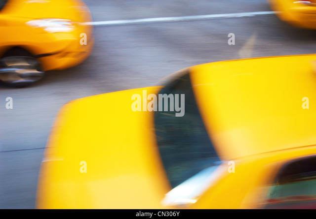 Yellow taxis in motion, New York City, USA - Stock Image
