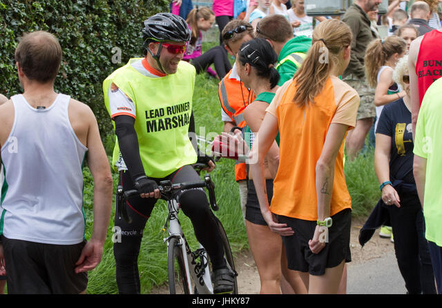 Cyclists at road running race - Stock Image