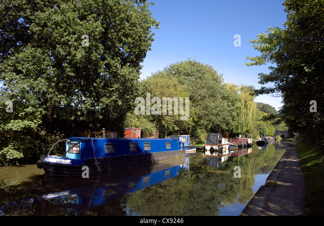 Boats on the Grand Union Canal, Warwickshire, England, UK, narrow, boat, cruiser, boats, boating, narrowboat, narrowboats, - Stock Image