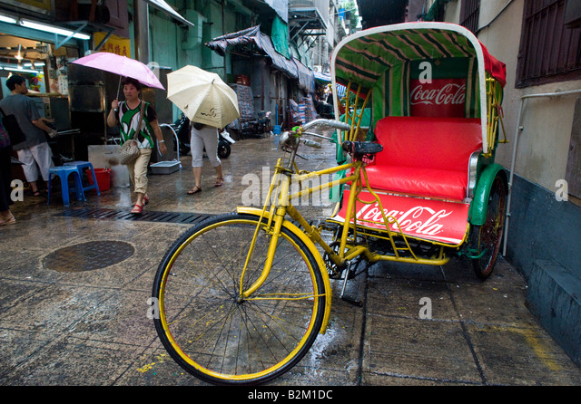 Traditional tricolo tricycle parked in street in Macau China 2008 - Stock Image