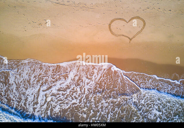 Aerial view of the Italian wild beach at sunset - Stock Image