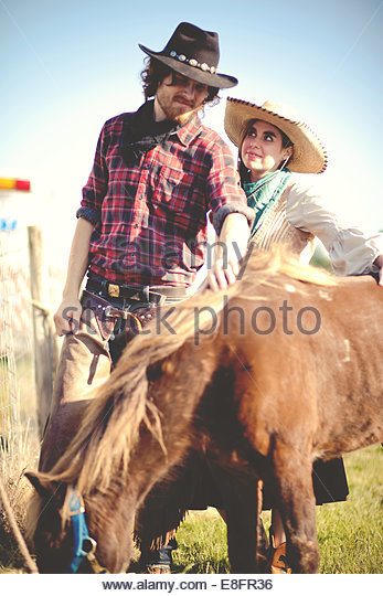 Cowboy and cowgirl couple with pony - Stock-Bilder