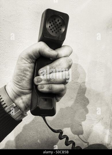 Hand with telephone Hand set - Stock Image