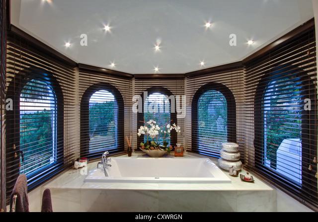 Bathtub in modern bathroom - Stock Image
