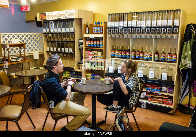 Illinois Normal Uptown East Beaufort Street Coffee House cafe bulk coffee syrup display table chair business man - Stock Image