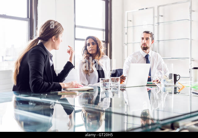 Business people planning at conference table during meeting - Stock-Bilder