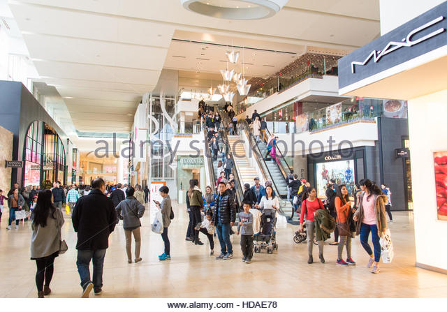 Inside view of Yorkdale Shopping Center in Toronto brimming with people. Various brand shops visible in the background. - Stock Image
